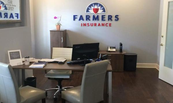 A photo of the inside of a Farmers agent's office