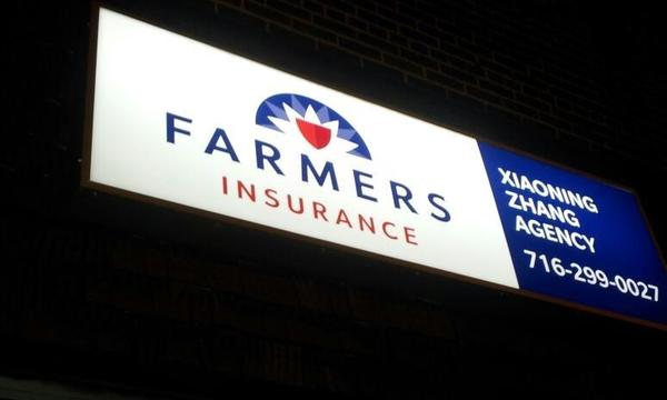 An office sign for Farmers Insurance