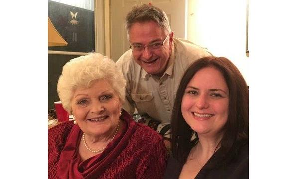 Agent Wes Prater with two female family members at a Christmas party