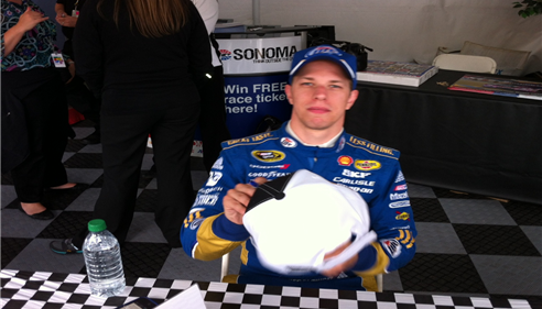 Brad keselowski signing my Farmers Insurance Group hat.