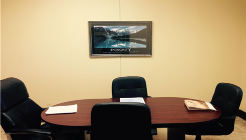 This is our conference room where we hold our staff meetings and training sessions.