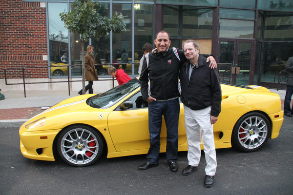 My father and I in Kansas City, Missouri with a car that I insure.
