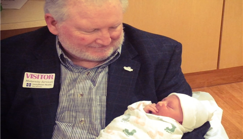 Larry and newest grandson, Henry Novak. 2015