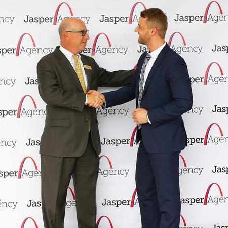 Two men dressed formally shaking hands