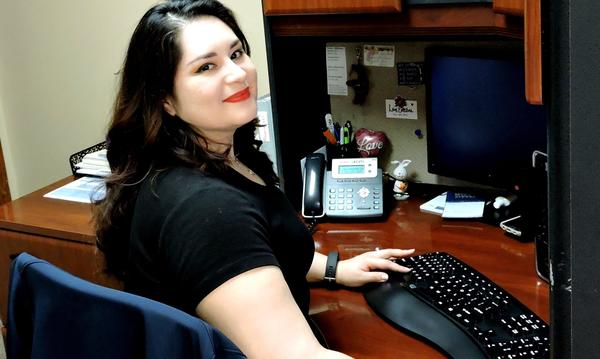 A staff member working at her desk.