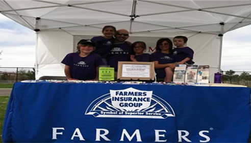 My family in the Farmers® booth at the March of Dimes 5K, May 2013.