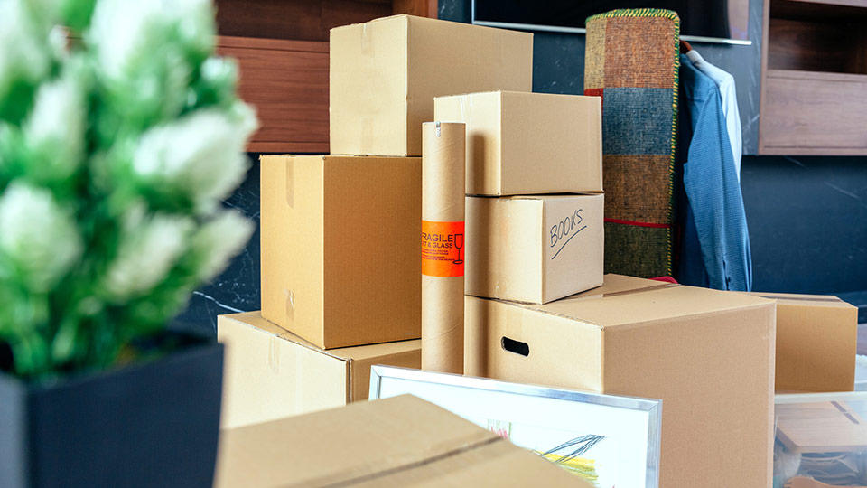 A student's entire dorm room is packed up in moving boxes