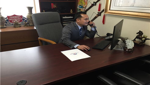 Hung Nguyen Working on a Farmers® Friendly Review with clients.