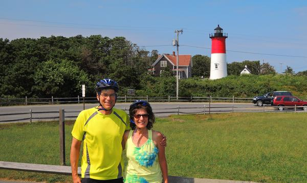 Agent and his wife in front of a lighthouse