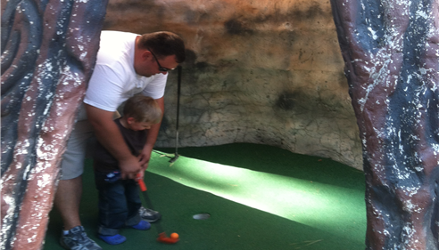 Having a blast teaching my son how to play mini golf up in Tahoe.