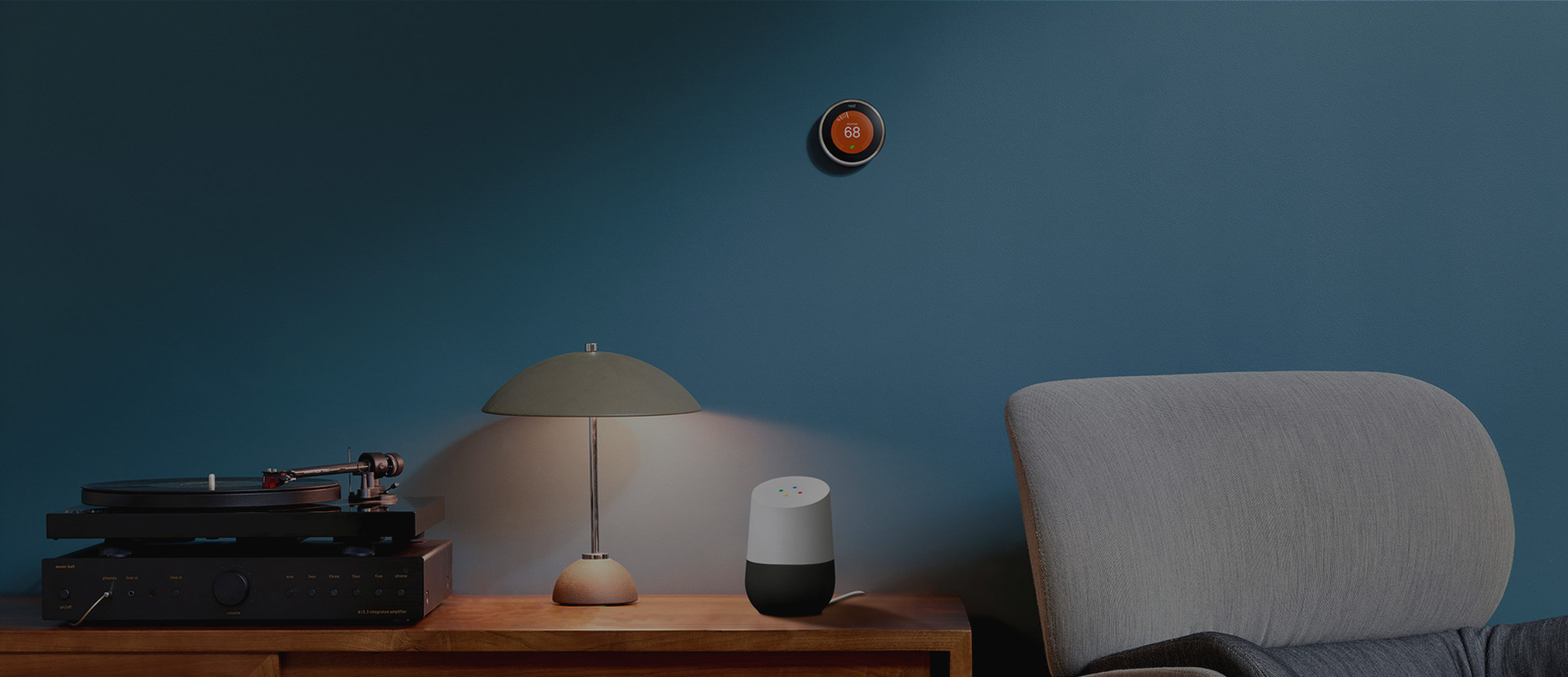 Living room photo of a connected Smart Home with Google Home and connected thermostat devices