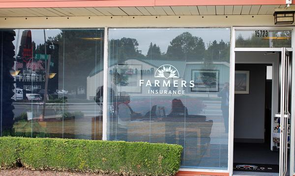 The exterior of the Agency with the Farmers logo on the window