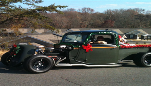 hunter green classic car with winter decor.