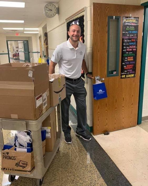agent delivering gift bags to teachers