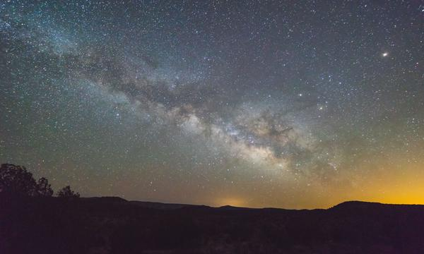 Photo of Milky Way in sky from ground perspective
