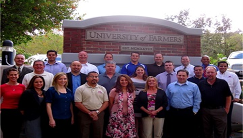 23 Farmers agents standing together at Farmers University