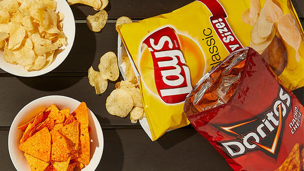 lays and doritos chips in a white bowl