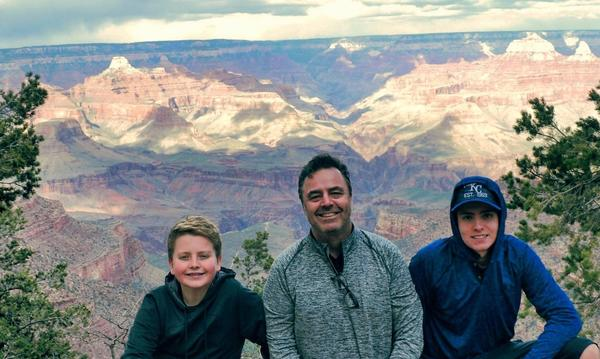Agent Doug Blasing and his two sons at the grand canyon