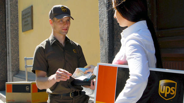 UPS driver delivering international package