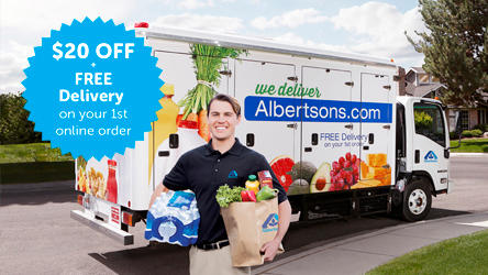 Delivery man standing in front of Albertsons grocery delivery truck holding groceries.