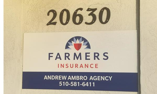 "A sign that reads, ""20630 Farmers Insurance Andrew Ambro Agency (510) 581-6411"""