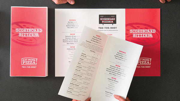 pizzeria menus at counter