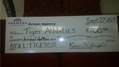 The Krizan Agency presented a check to Tiger Athletics for 2013 Football