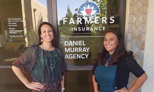 "Two women standing in front of a Farmers Insurance Office that reads, ""Daniel Murray Agency"""