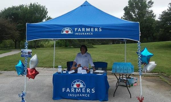 An outdoor promotional booth for Irene Morgan Agency Farmers Insurance.