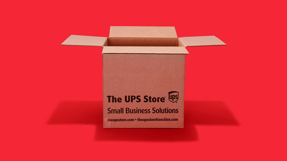 A sturdy shipping box with the text The UPS Store - Small Business Solutions - theupstore.com