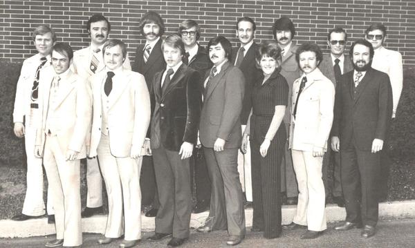 A group of men posing after becoming Farmers agents in 1976