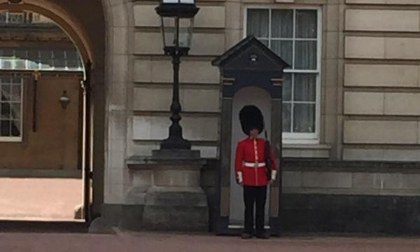 Photo of the changing of the guard at Buckingham Palace.