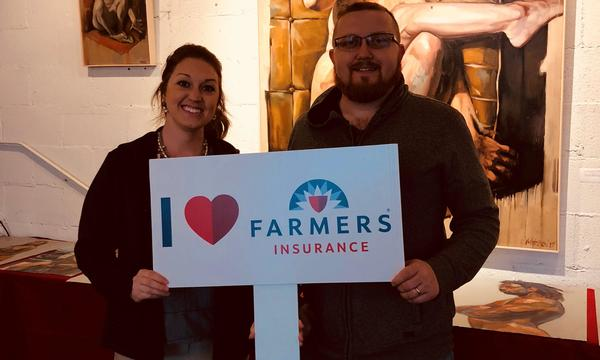 "Man and woman holding a sign that says ""I Love Farmers"""