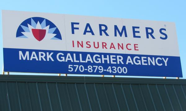Farmers Insurance promotional billboard.
