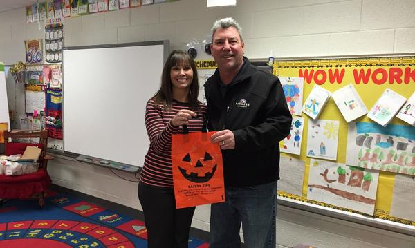 Handing out Halloween bags for local first graders   :)
