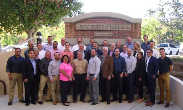 Agent Lukas Perry standing with other agents at the University of Farmers in LA.