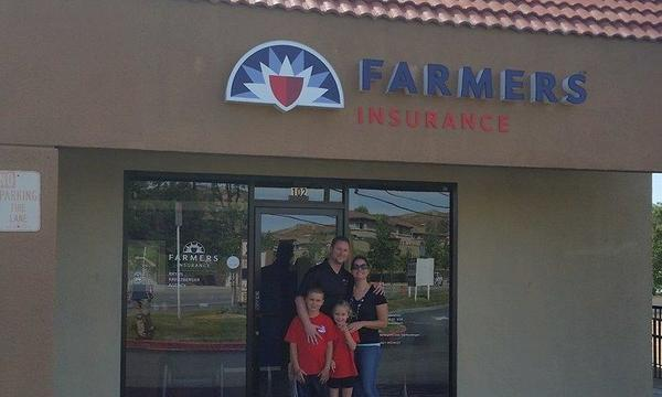 Family standing outside of Farmers Agency.