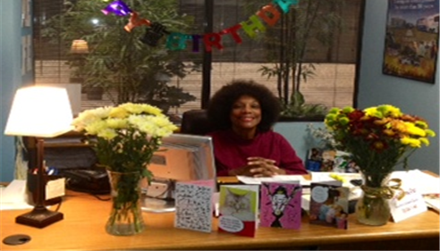 Christine Degele Agency employee, Cynthia, at her desk celebrating her 65th birthday.