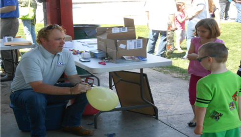 Agent Jacob Hainsfurther at an outdoor community event for children