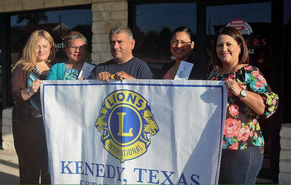 People holding flag for the local Lions Club International