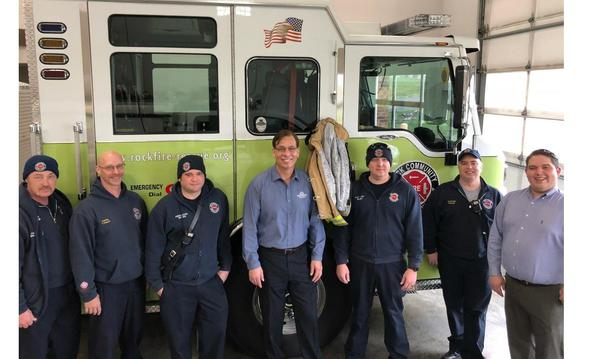 Agent Michael and staff member posing with 5 local firefighters
