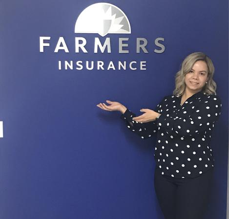 agent presenting farmers insurance logo on their wall