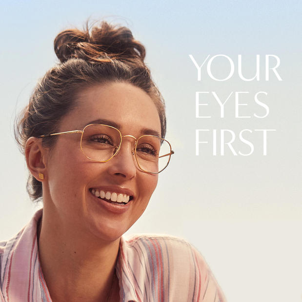 Woman smiling while wearing LensCrafters eyeglasses