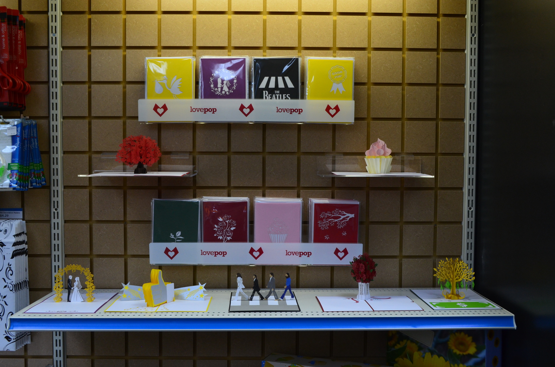 Love Pop greeting cards on display shelf.