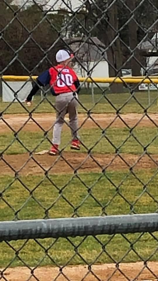 young baseball pitcher on the mound