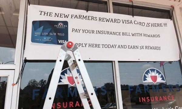 Banner for the New Farmers Reward Visa hung outside the agency office