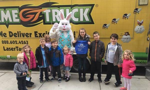 Kids posing with the Easter Bunny.