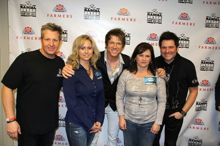 Group standing with Rascal Flatts