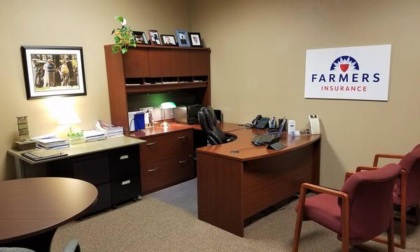 Agent Scott Tarsi's desk with chairs for customers to sit in front of it.