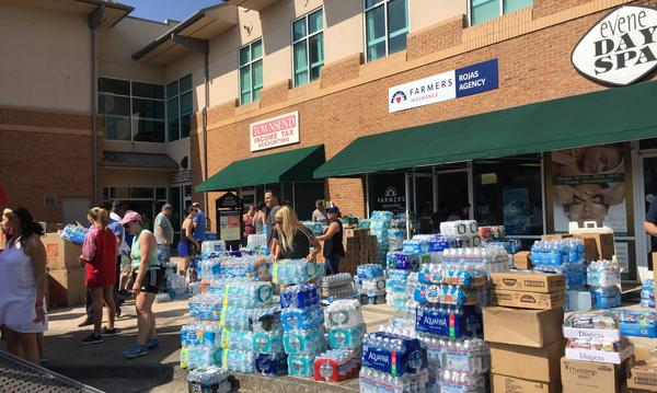 Supplies outside of Farmers Insurance Agency ready to be shipped off to Puerto Rico for donation